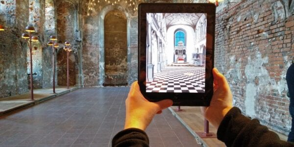 A Person Using an AR Application on a Tablet.