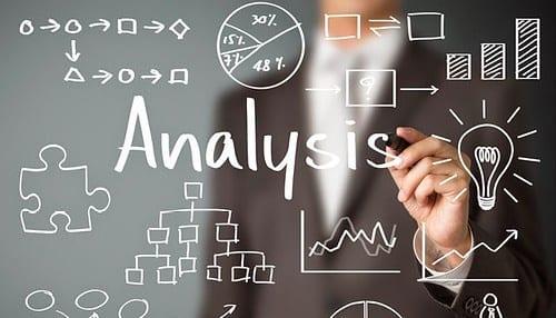 Image of man brainstorming around the word analysis