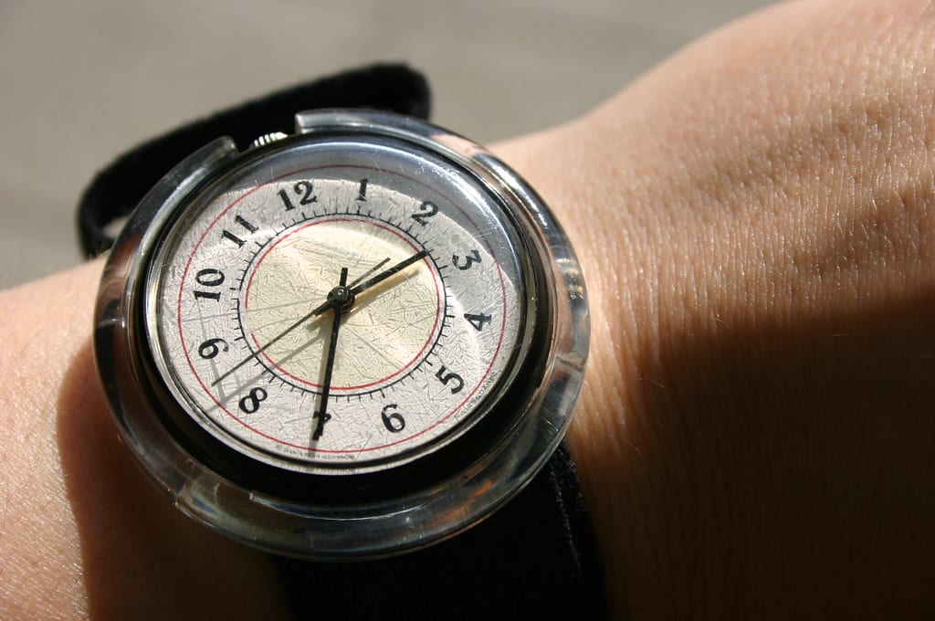 A watch on a wrist telling the time.