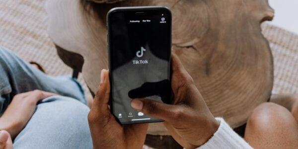 Person Using TikTok on Smartphone
