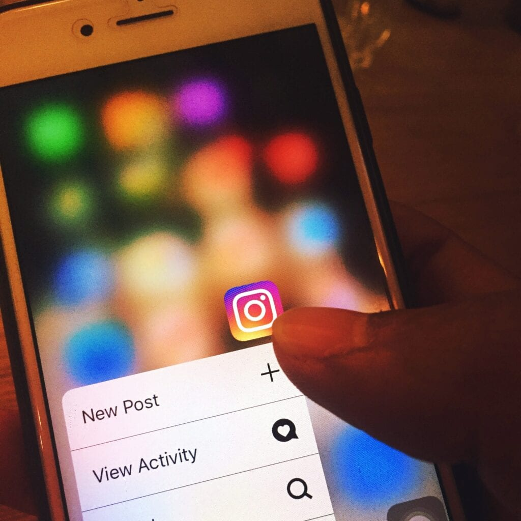 Tapping Instagram App on Smartphone