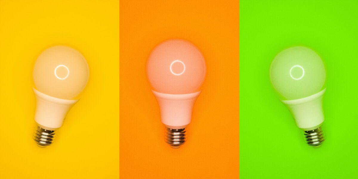 Three colourful light bulbs.