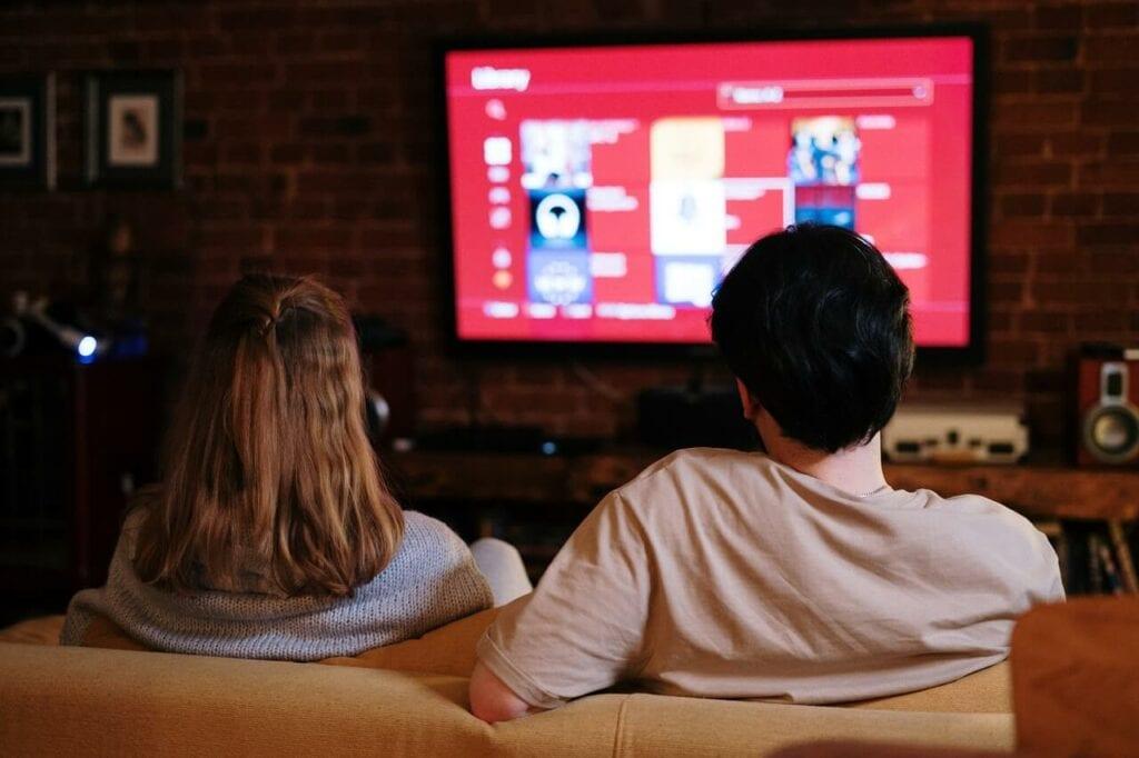 Family shopping through the TV. Shoppable TV.