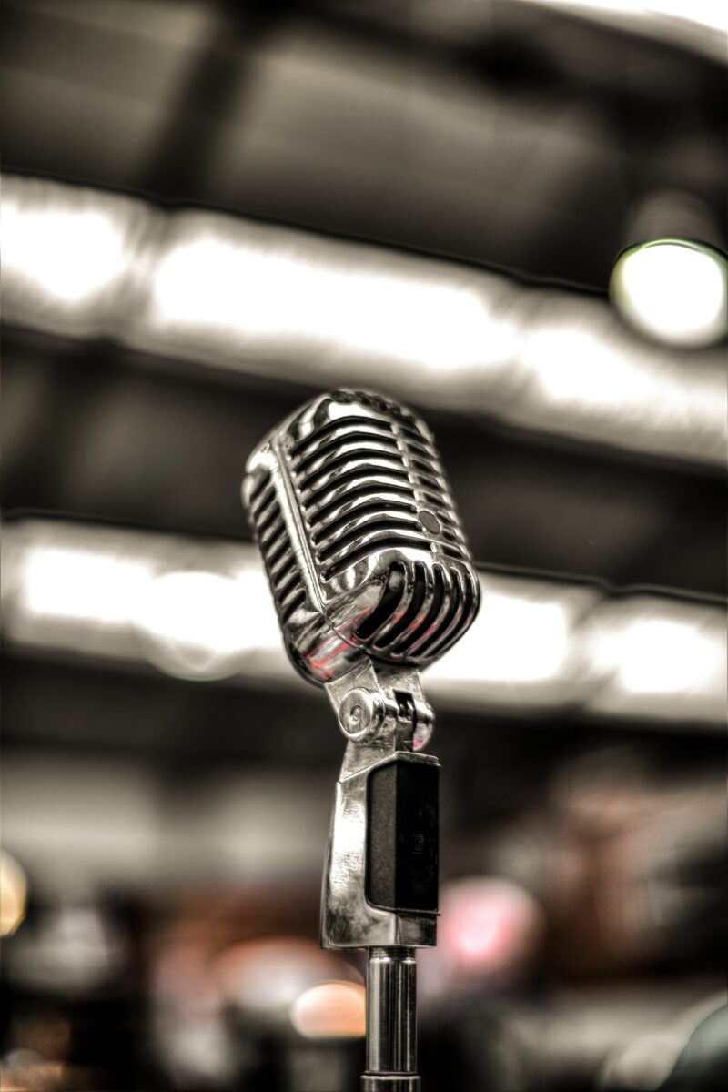 Close-up image of silver-coloured microphone on a stand